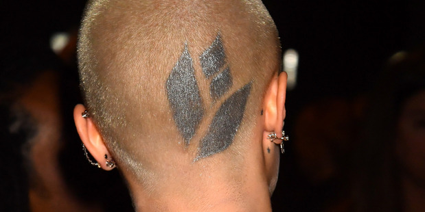 Cara Delevingne reveals her new tattoo at the MTV Movie & TV Awards in Los Angeles. Photo / Getty