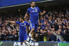 Diego Costa celebrates with Pedro after scoring for Chelsea during their 3-0 victory over Middlesbrough in London this morning (NZT). Photo / Getty Images.