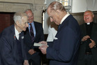 Prince Philip, Duke of Edinburgh reads a letter he wrote to former naval commander Keith Evans, left, now aged 97, after the announcement of his engagement to Queen Elizabeth. Photo / Getty