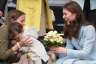 This shy youngster quickly cuddled into his mother after handing Kate a bouquet of flowers. Photo / Getty
