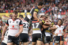 Matt Moylan celebrates with his Penrith teammates after scoring a try against the Warriors. Photo / Getty Images
