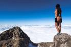 Playmate Jaylene Cook climbed Mt Taranaki, posing naked for images near the summit. Photo / Josh Shaw