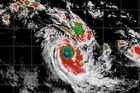 The tropical cyclone that has been battering Vanuatu has been upgraded to the highest category.
