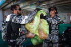 Members of HMAS Arunta's boarding party account for seized illegal narcotics found during the search of a dhow while on patrol in the Middle East Region. Photo supplied