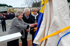 CLOSE CONNECTION: Norma Hempel (left), Val Merwood and Beryl Donovan cut the ribbon on their fathers' memorial (right).