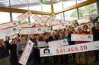Local organisations with their cheques from the 2016 Charity House proceeds. Photo/supplied