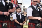 BAGPIPES BOY: 11-year-old Josh Murray helped lead the graduation procession down Devonport Road yesterday. Photo/George Novak