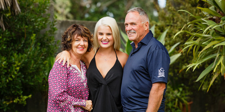 Bachelorette Claudia Hoskins, 21, with her mum Debbie Hoskins and dad Steve Hoskins on her hometown visit on the show. Photo / Supplied by Mediaworks