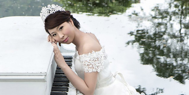 The more traditional white is for the princess side of her, Q May Chen said.