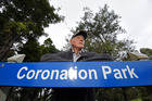 Veteran tour operator John Mathieson and the trees threatened by construction of Mount Maunganui's visitor information centre.