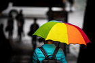 Umbrellas were out in Auckland's CBD this morning. Photo / Michael Craig