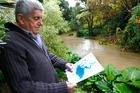 Bill Buchanan ... keeping a watchful eye on the rising Matarawa Stream.