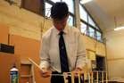 Bronson Barron with the model of the pirate ship he and fellow carpentry students are making for Gonville Kindergarten. Photo/Stuart Munro