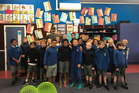 Mark Kerr with pupils at St Michael's Catholic Primary School. Photo/supplied