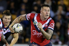 Shaun Kenny-Dowall takes the ball to the line for the Roosters. Photo / Photosport.co.nz
