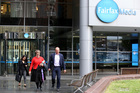People leave the Fairfax offices in Sydney last week after the job cuts announcement. Photo / AP