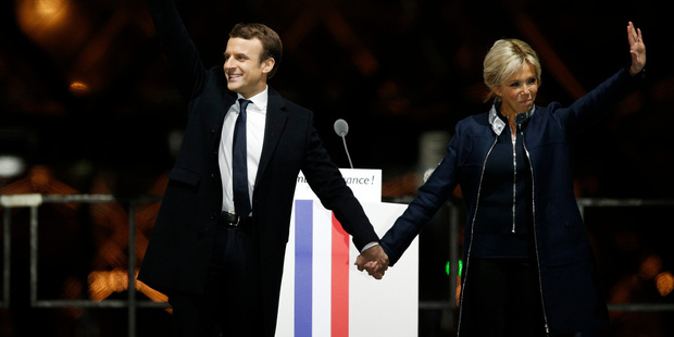 French kiss: passionate Macron supporters celebrate their new president