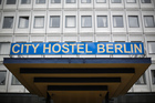 View of the entrance of the City Hostel Berlin located in part of the North Korean embassy in Berlin. Photo / AP
