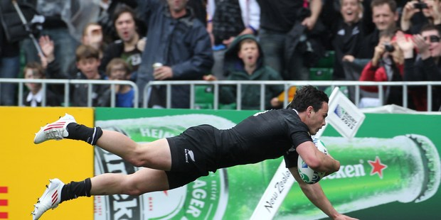 New Zealand's Zac Guildford, scores in the Rugby World Cup Pool match against Canada at the Wellington Regional Stadium in 2011. Photo/File