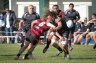 Rangataua's Jesse Parete is hit hard and loses the ball during last Saturday's game against Whakarewarewa. Rangataua will be looking to score back to back wins over Rotorua opposition when they visit Emery Park tomorrow. Photo / Andrew Warner