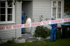 Police forensic investigators at the home of Eunice Lyttle yesterday. Her death is now being treated as suspicious. Photo/Dean Purcell