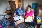 Fapiano Lemeki (left) and Mafi Lemeki with goods donated by the community. Photo: NZH/Jason Oxenham