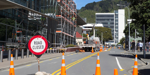 Earlier this year  up to 250 Wellington buildings needed unreinforced masonry to be pulled back and secured. The new list only has 108 buildings on it. Above, scaffolding goes up at the GCSB and SIS building after the November 14  quake. Photo /  Mark Mitchell