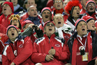 Lions supporters join in with the Welsh choir before kick-off in the first test at Jade Stadium in Christchurch, June 25, 2005.