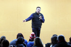 Comedian Mike King speaking to school students about mental health. Photo/file