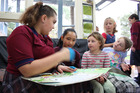 Rutherford year seven students Kyah Boothby (11) and Febelyn Kitongan (11) read to Gonville kindergarten kids. Photo/ Emma Russell