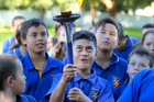 Shalom Maa, Year 6 holds the flaming torch as the school takes part the Sri Chinmoy Oneness-Home Peace Run, a global relay seeking to inspire the creation of a better world. Photo/Warren Buckland