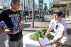 Napier resident Matthew Kingi (left) gets the signature of Jack Morgan of Hastings - one of over 300 he has gathered for his anti-fluoride petition. Photo / Warren Buckland
