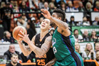 Hawks swingman Tony Tolovae drives into the lane with Rangers guard Earnest Ross jnr keeping him in check at the PG Arena, Napier, tonight. PHOTO/Paul Taylor