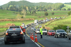 Traffic delays on SH10 at Bulls Gorge after a series of crashes caused by a diesel spill. Photo/Peter de Graaf