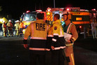 Kawakawa's deputy fire chief Alistair Leitch briefs Whangarei firefighters outside the freezing works during Friday night's ammonia leak. Photo / Peter de Graaf