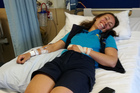 Paihia firefighter Tanya Bijl in hospital after almost chopping off a finger. PHOTO / SUPPLIED