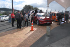 EV enthusiasts check out this Tesla Model X, complete with falcon-wing doors, for size at Whangarei's Canopy Bridge