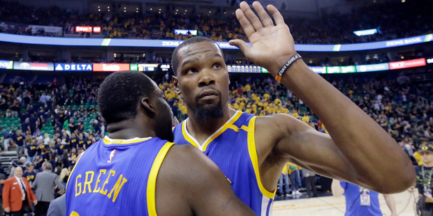 Golden State Warriors' Kevin Durant, right, receives a hug from teammate Draymond Green. Photo / AP