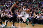 Boston Celtics guard Isaiah Thomas drives to the basket past Washington Wizards forward Markieff Morris. Photo / AP