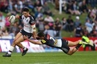 Shaun Johnson is tackled by Nathan Cleary during last night's loss at Penrith. Photo / photosport.nz