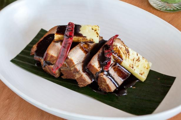 Roast pork (Pua'a Samoa) cleverly smoked to depict hints of a hangi before being finished with a mole-like Koko Samoa glaze of chocolate, coffee, pepper and berries.