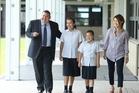ACG Tauranga's principal Shawn Hutchinson, his wife Mayumi, and their daughters Lina, and Mei. Photo/John Borren.