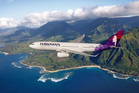 A Hawaiian Airlines Airbus A330 plane over Hawaii.