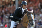 New Zealand's Andrew Nicholson on Nereo attacks a jump during the show jumping phase . Photo / AP