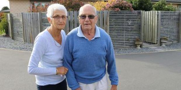 Sanctuary Villas residents Kathleen and Glyn Hardy are refusing to sign off on changes to a fence they say is illegal and dangerous. Photo / Christchurch Star