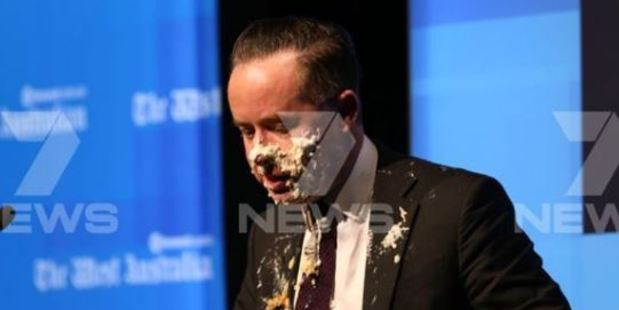 Qantas airline chief hit with pie in face during speech