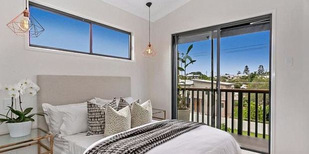 The townhomes boast high ceilings, chic design elements and private balconies. Photo / Ray White