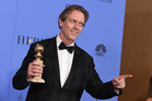 Hugh Laurie poses in the press room with the award for best performance by an actor in a supporting role in a series, limited series or motion picture made for television for