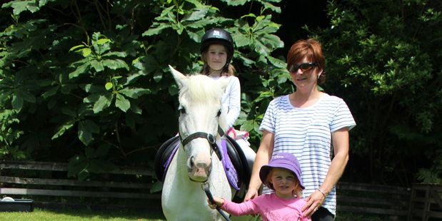 Hayley Webb (7) enjoyed a ride on Prickles, led by Christine Evans and Clare Coatsworth (5).