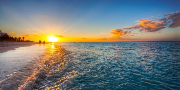 The sun sets over Grace Bay beach in Turks and Caicos. Photo / 123RF